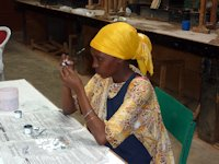 Woman painting jewelry